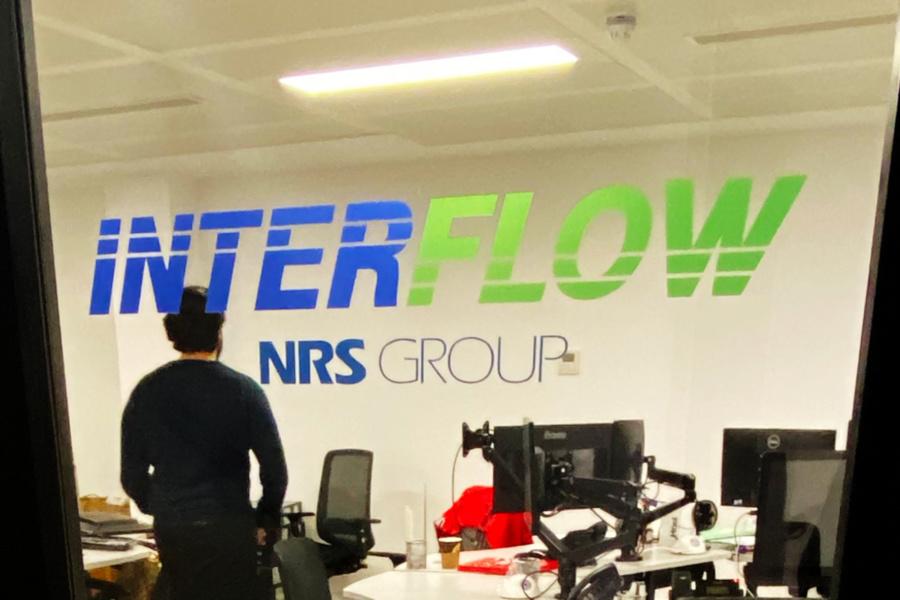 Interflow NRS Group - office door glass logo manifestation